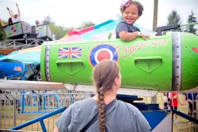 Stephanie Crow of Raymond shares a glance with her daughter Annie, 4, as she passes by on a 'Fighter Ace' amusement ride at the Pacific County Fair