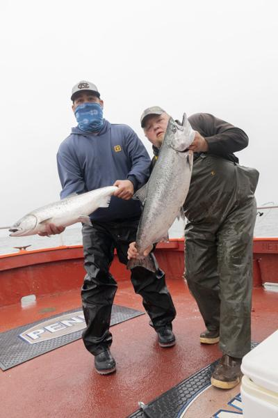 Smith and Tucker with keeper Chinook