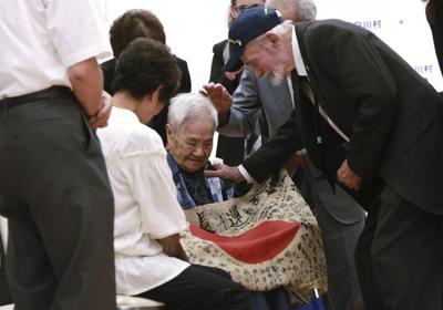 Veteran returns a dead Japanese soldier's flag to kin