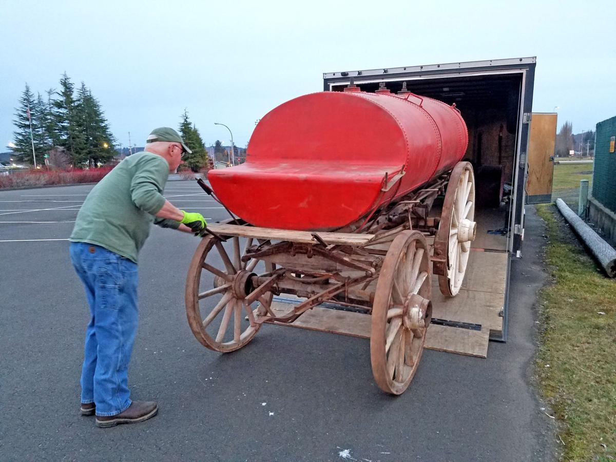 Kerosene wagon being unloaded