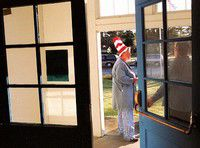 Superintendent comes to class as Cat in the Hat for Seuss day