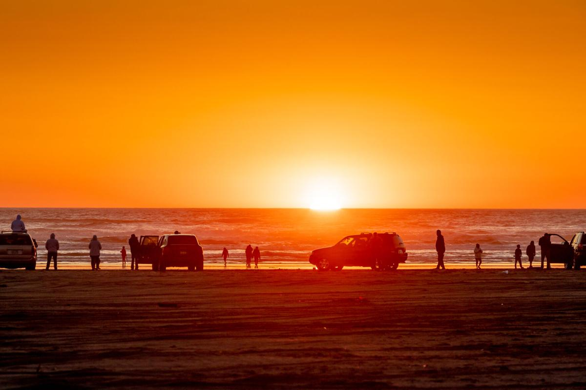 People gather for sunset