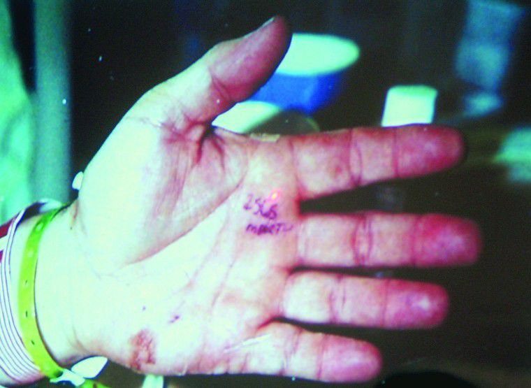 Johnson put alleged shooter's name on his palm