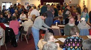 Crowded caucus picks Kerry for candidate