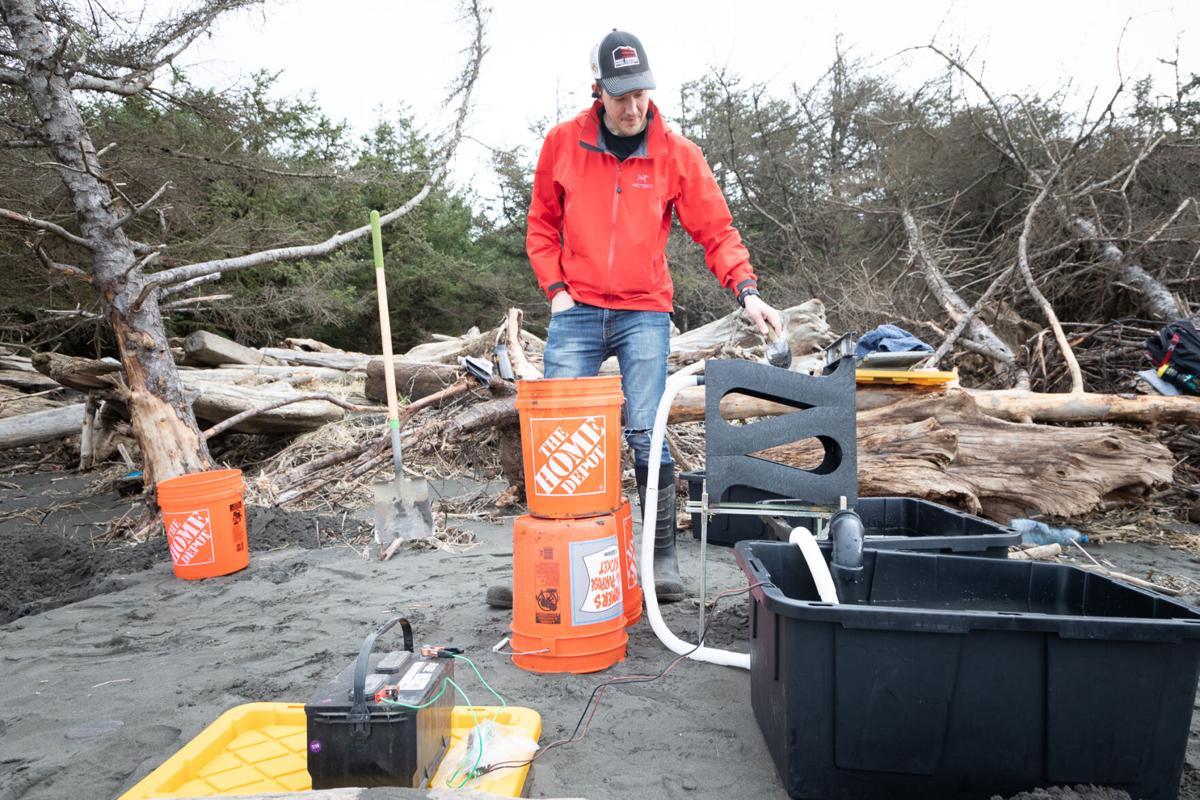 Tomlinson ladles scoops of black sand