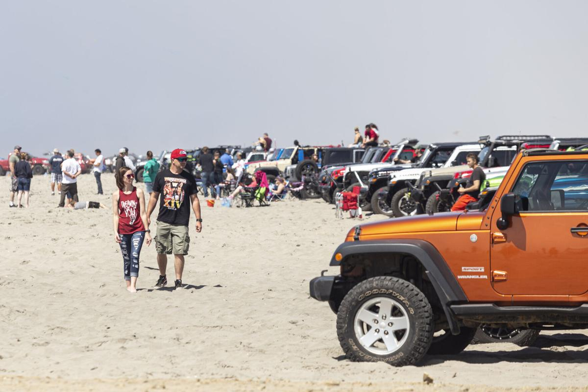 Man and woman browse Jeep vehicles