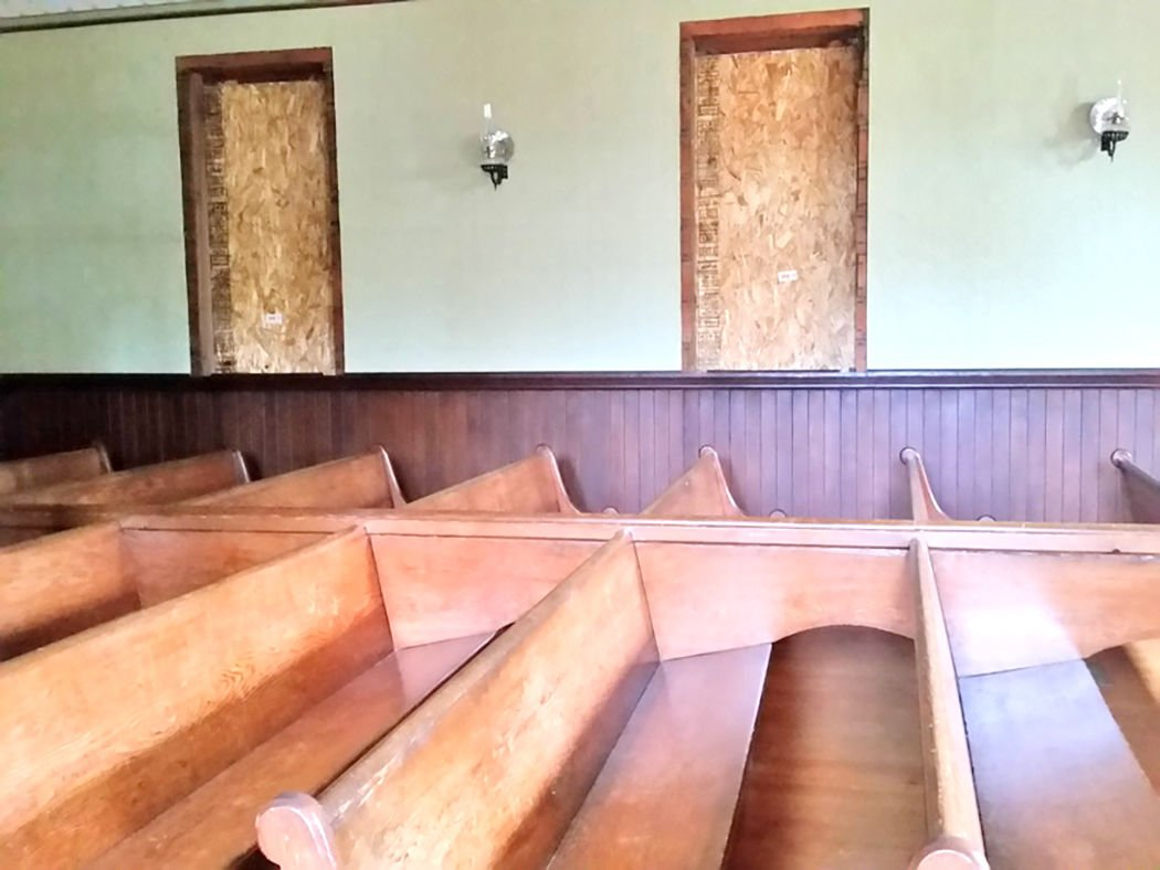 Inside Oysterville Church with boarded-up windows