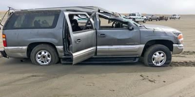 SUV that flipped on the beach