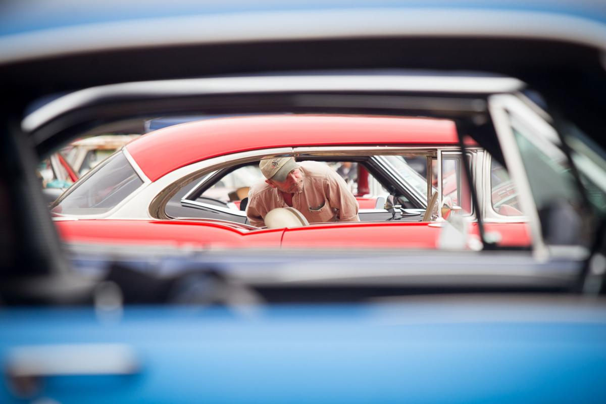 Sterling Johnson of Kelso peeks into the window of a classic car Saturday during the Rod Run event in Ocean Park