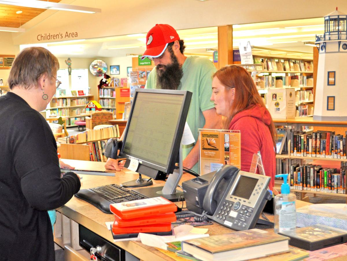 Jenny Grenfell assists library patrons