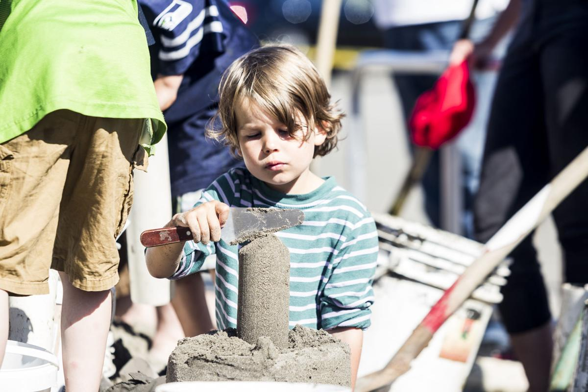 Connor Hogan, 6, concentrates on building a sandcastle during the 35th annual Sandsations event in Long Beach.