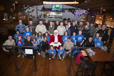 More than 35 children and law officers join in annual 'Shop with a Cop'