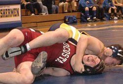IHS splits 30 bouts at home meet