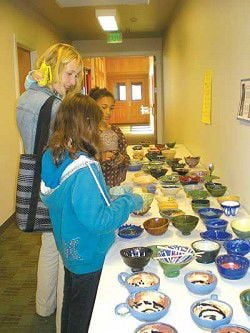 Student potters fill empty bowls and empty bellies