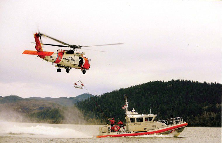 Happy New Year From the United States Coast Guard Station Cape Disappointment, The National Motor Life Boat School & U.S.C.G. Auxiliary Flotilla 62