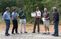 Charlie Stenvall presented the '2003 Excellence in Partnership Award' by the Coastal Resources Alliance