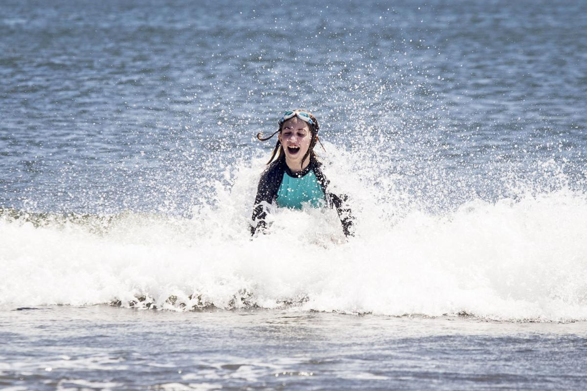 June Rose catches a wave