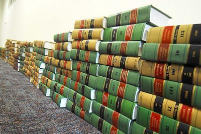 Young lawyers bring donated law library to Long Beach