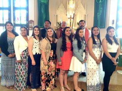 Nine confirmed into Catholic Church