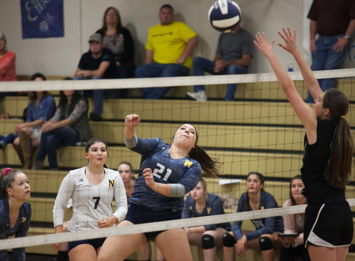 Comets fly over Eagles in 3 sets