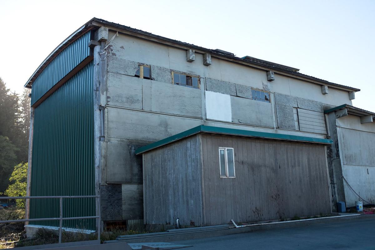 Rustic boat workshop partially demolished