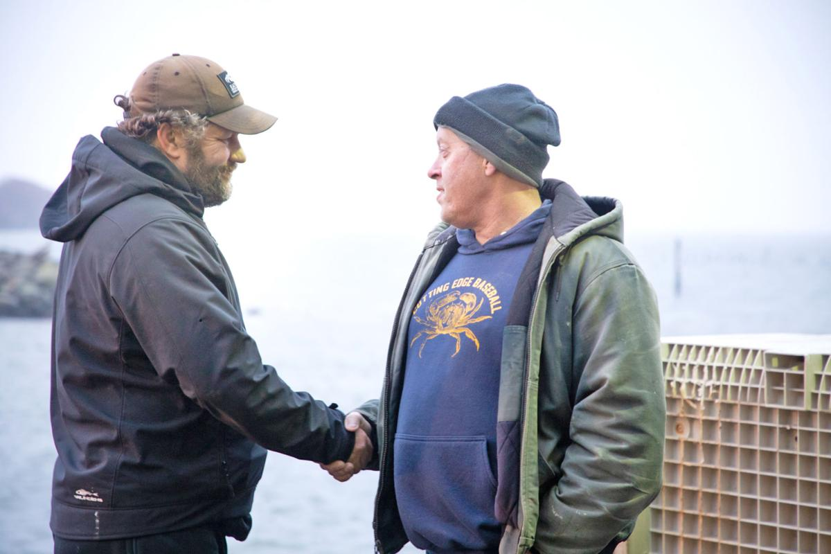 Ilwaco Landing co-owner Mike Shirley shakes hands with F/V Cutting Edge captain Brian Cutting