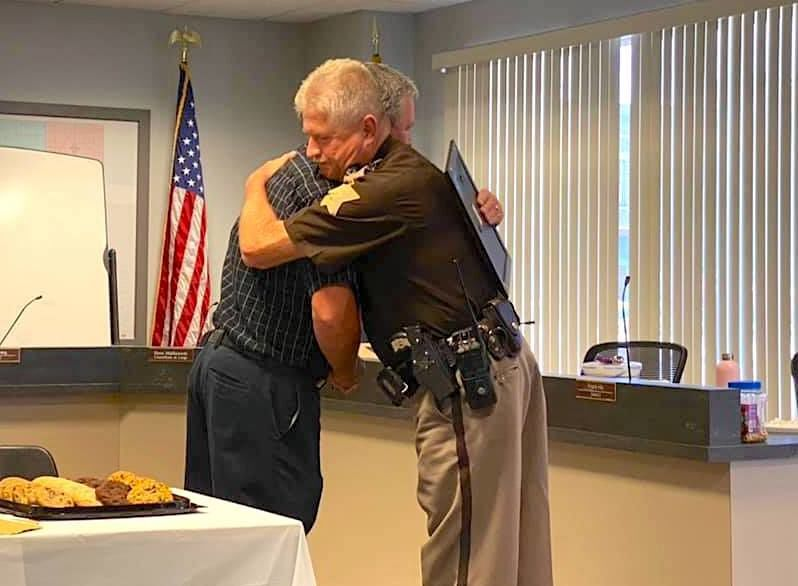 Capt. Beaty hugs Albertson