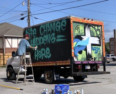 Riley Gregor paints box truck