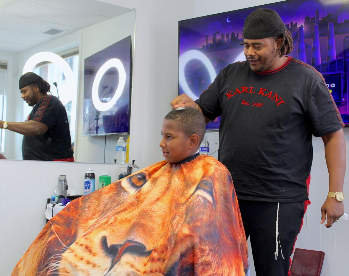 Barber opens shop to inspire community