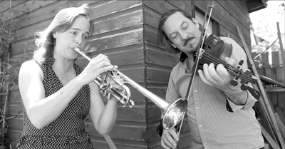 Merrie Klazek and her husband Pierre Schryer rehearse in the backyard of their Thunder Bay home on Monday.