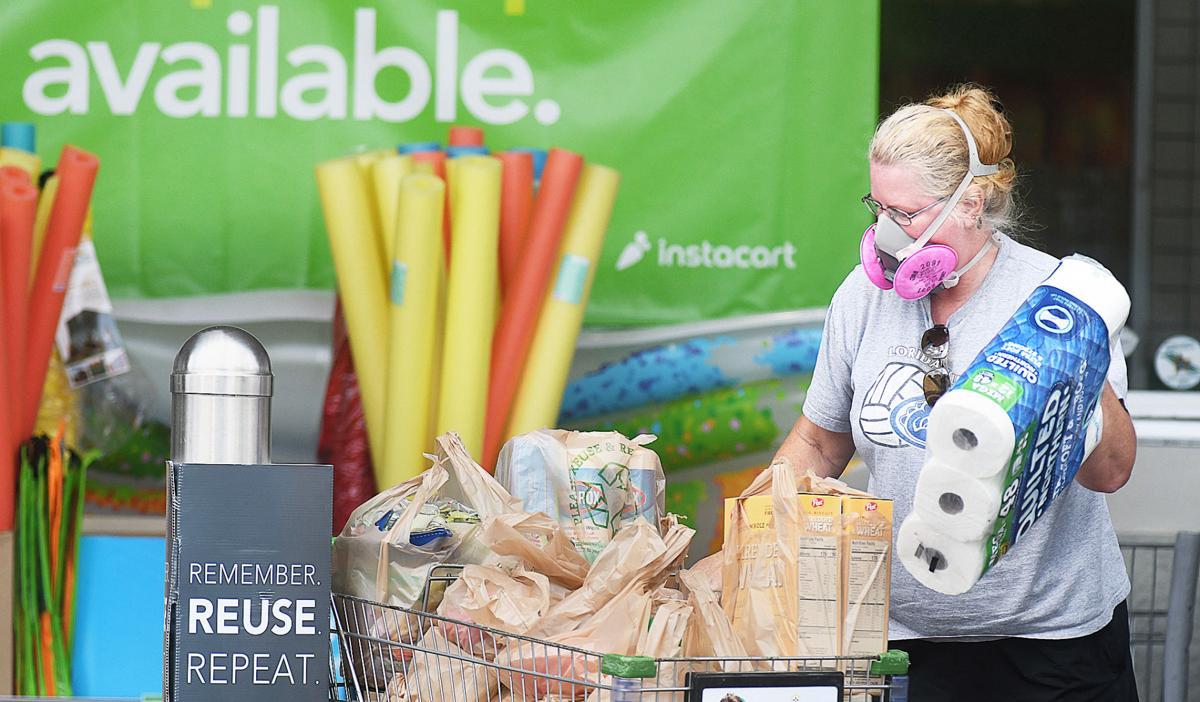 Mask-wearing grocery shopper