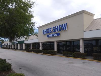 Shoe Show sign goes up