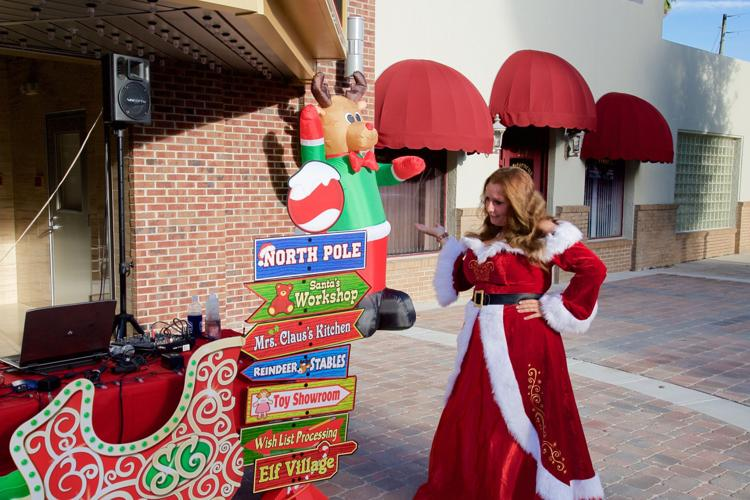Mrs. Clause with Sign