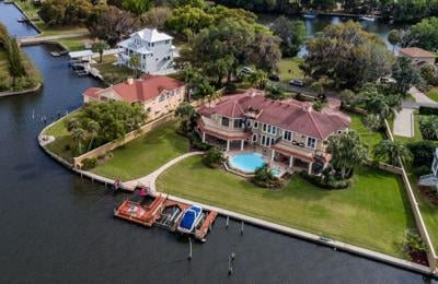 062620_WATERFRONT_MANSION  home aerial dominant