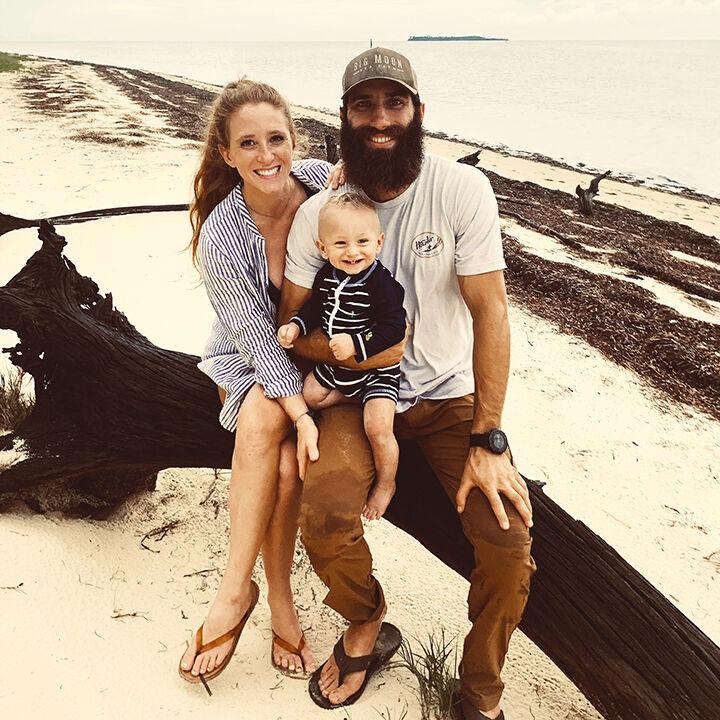 Hannah and Ian Stone with their son, Silas, 1, on Seahorse Key.jpg