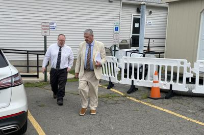 Matthew Landmesser, left, leaves central court with his attorney, Mark Bufalino.