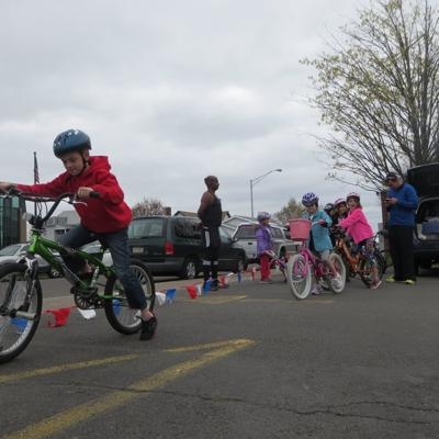 Children practice bicycle safety