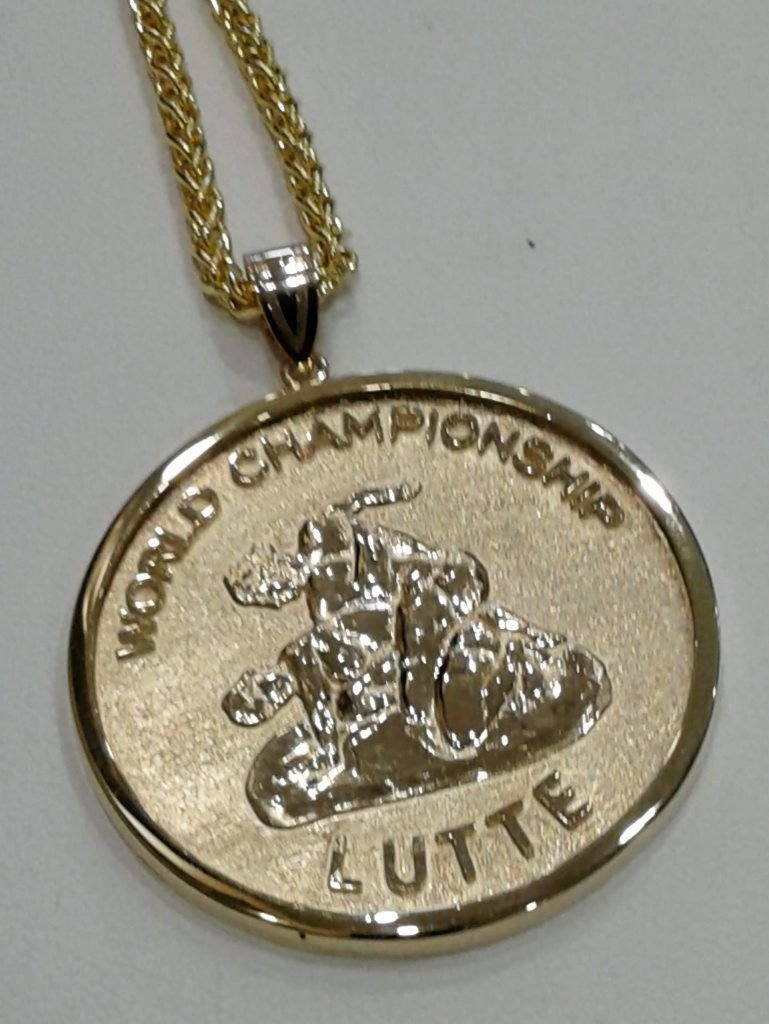 Local jeweler designs international wrestling medal