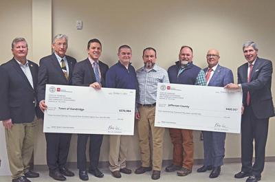 Rolfe comes to Jefferson County to present grant checks