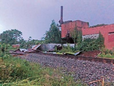 Storm blows factory roof onto tracks