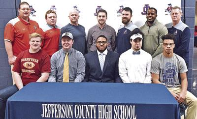 Five Patriots sign to continue football careers