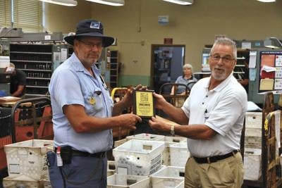 Postal carriers present donation to Daily Bread