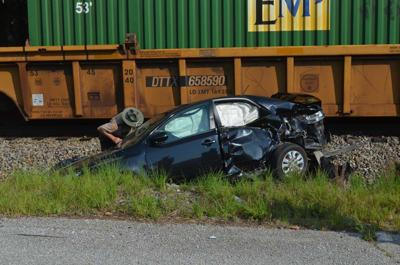 Woman injured when car struck by train