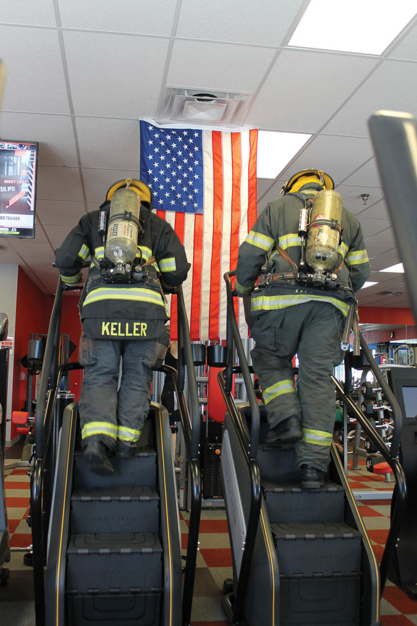 Firefighters climb stairs in memory of fallen heroes