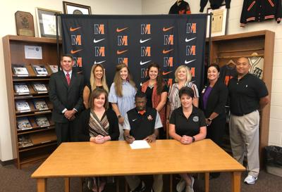 Scott signs with East High