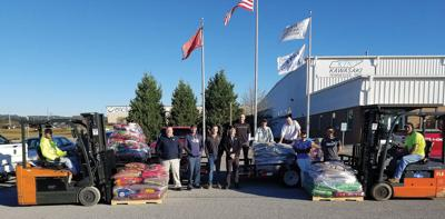 Kawasaki employees raise 5,020 pounds of pet food