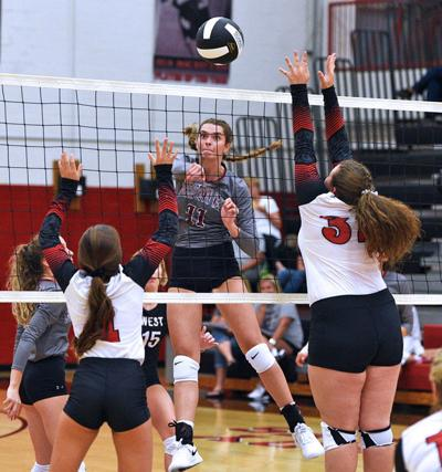 Lady Trojans cruise to straight-set win at Cherokee