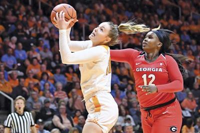 Davis, No. 23 Lady Vols ease past Georgia 73-56