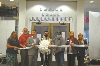 Camden Klein Photography cuts  ribbon on College Square Mall location