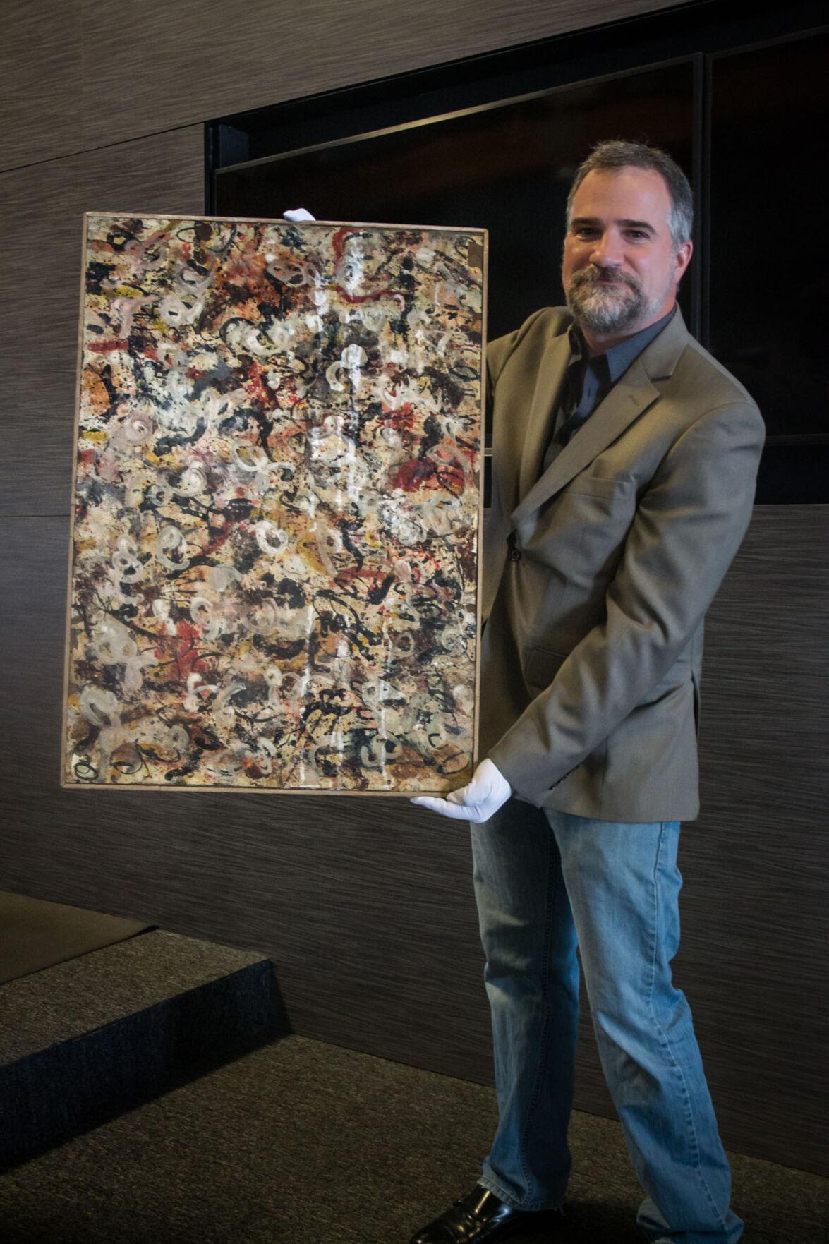 Josh Levine holds Jackson Pollock gouache painting – photo_Sami Gill